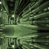 Pipes inside energy plant. Different types of pipes and tanks inside energy plant Royalty Free Stock Image