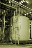 Pipes inside energy plant. Different types of pipes and tanks inside energy plant Royalty Free Stock Photography