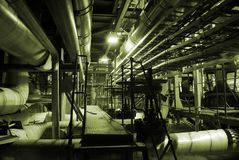 Pipes inside energy plant. Different types of pipes and tanks inside energy plant Stock Photos