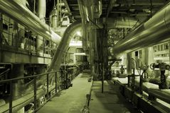 Pipes inside energy plant Stock Images