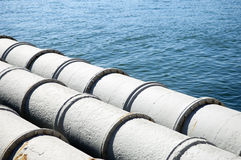 Pipes leading out to sea. A closeup of large sewage pipes, leading out to the sea Royalty Free Stock Image