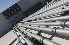 Pipes Leading To Electrical Boxes. At solar power plant Royalty Free Stock Image