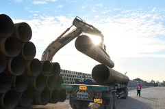 Pipes loading. Pipes uploaded to trailer using Vacuum lifter Stock Photo