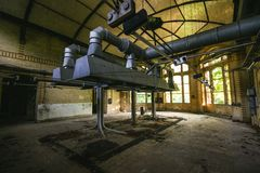 Pipes machinery and turbine at an abandoned place royalty free stock images