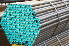Metal Tube Warehouse. Pipes made of metal in the outdoor warehouse Royalty Free Stock Image