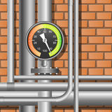 Pipes and manometer in a boiler room. Royalty Free Stock Photos