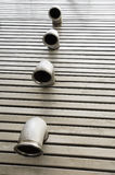 Pipes in a metal floor. Pipes in a stainless steel metal floor Royalty Free Stock Photos