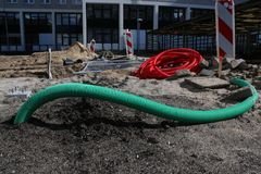 Pipes an other materials laying on the ground at a unfinished construction site royalty free stock photo