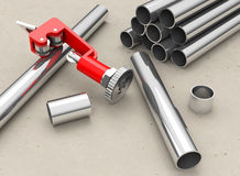 Pipes and pipe cutter Royalty Free Stock Photos