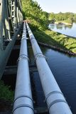 Pipes. On the river by the bridge royalty free stock photography