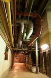 Pipes at a power plan. An assortment of different size and shaped pipes at a power plant Royalty Free Stock Photography