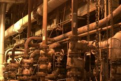 Pipes at a power plant. Different size and shaped pipes at a power plant Royalty Free Stock Photo