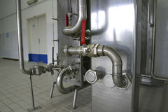 Pipes pressure valves in factory Stock Photo
