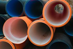 Pipes of PVC large diameter. Prepared for laying on construction site royalty free stock photography