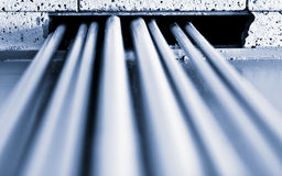 The pipes rising to the ceiling. The abstract image of pipes for cable grooming Stock Photo