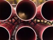 Pipes rouges de PVC Photographie stock libre de droits