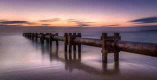 Pipes in the Sea at the Coast Stock Photography