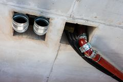 Pipes of sewage, ventilation, water supply in the created interior stock images