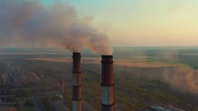 Pipes with smoke: industrial production. Thick smoke comes from industrial chemney. Concept air pollution. stock video