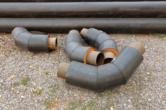 Pipes stacked in construction site ready for mount Stock Photos