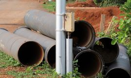 Pipes beside Street Light. Image of a Pipes beside Street Light royalty free stock photo