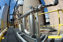 Pipes and tanks. In chemical factory Royalty Free Stock Image