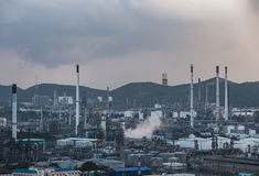 Pipes and tanks of oil refinery - factory Stock Images