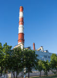 Pipes of a thermal power plant in Ufa against the blue sky Stock Photo