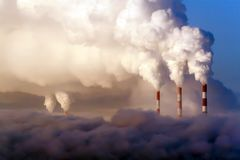Pipes of thermal power plants emit thick smoke. Thermal power plants in thick fog. Probable air pollution royalty free stock photos