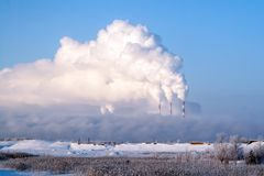 Pipes of thermal power plants emit thick smoke. Thermal power plants in thick fog. Probable air pollution royalty free stock photography