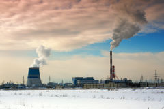 Pipes of thermal power station. Steam and smoke. Industrial factory landscape Stock Photos