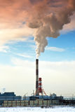 Pipes of thermal power station. Steam and smoke. Industrial factory landscape Stock Images