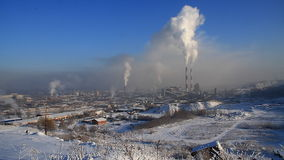 Pipes throwing smoke in the atmosphere. Industrial landscape with smokestacks pollute atmosphere stock video