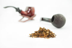 Pipes and tobacco Stock Images
