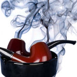 Pipes and  tobacco smoke Stock Images