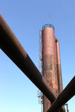 Pipes and Tower. Rusting pipes lead to an even more rusty tower at Seattle's Gasworks Park. The park used to be a manufacturing facility that converted coal and Royalty Free Stock Images