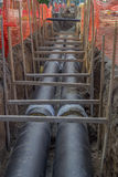 Pipes in trench, industrial pipeline Royalty Free Stock Photography
