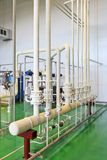 Pipes, tubes, machinery at factory. Pumphouse Royalty Free Stock Photography