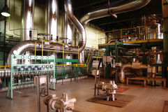 Pipes, tubes, machinery and at a power plant Stock Images