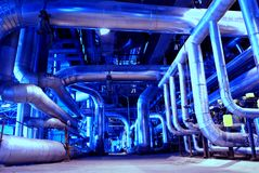 Pipes, tubes, machinery and steam turbine stock photography