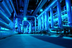 Pipes, tubes, machinery and steam turbine Stock Images