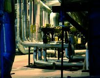 Pipes, tubes, machinery and steam turbine Royalty Free Stock Image