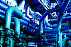 Pipes, tubes, machinery and steam turbine Stock Image