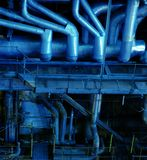 Pipes, tubes, machinery and steam turbine Stock Photos