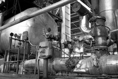 Pipes, tubes, machinery and steam turbine bw Stock Image