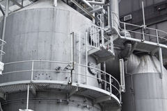 Pipes, tubes, machinery and steam turbine at a power plant Royalty Free Stock Images