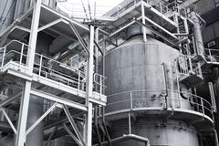 Pipes, tubes, machinery and steam turbine at a power plant Royalty Free Stock Photo