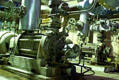 Pipes tubes pump steam turbine at power plant Royalty Free Stock Photos