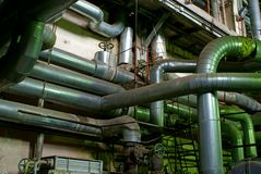 Pipes tubes pump steam turbine at power plant Royalty Free Stock Photography
