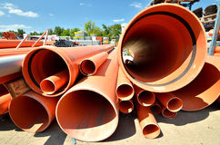 Plastic PVC water pipe. Pipes and tubing. Stack of industrial pipes for water transportation. Warehouse outdoor storage depot Stock Photography